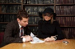 lawyer-reviewing-will-with-widow-200493685-006-5783f0763df78c1e1f547cd5