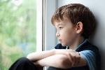 bigstock-Sad-Boy-Sitting-On-Window-87950486