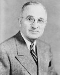 1200px-Harry_S_Truman,_bw_half-length_photo_portrait,_facing_front,_1945-crop