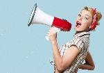 depositphotos_118556934-stock-photo-portrait-of-woman-holding-megaphone